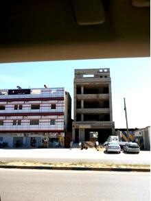 مبنى هيكل 4 طوابق و رفوجو و ملحق علي طريق الساحلي تصنيف تجاري كزيوني